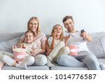 young happy family watching... | Shutterstock . vector #1014776587