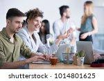 satisfied businessman working... | Shutterstock . vector #1014801625
