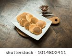 pancakes on a wooden board with ... | Shutterstock . vector #1014802411
