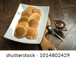 pancakes on a wooden board with ... | Shutterstock . vector #1014802429