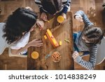 mother with two daughters... | Shutterstock . vector #1014838249