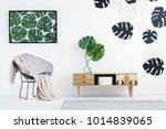 wooden cupboard with monstera... | Shutterstock . vector #1014839065