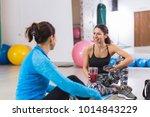 women taking a break in gym | Shutterstock . vector #1014843229
