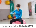 woman with smoothie drink in gym | Shutterstock . vector #1014843271
