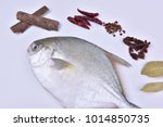 Small photo of Fresh golden bonito and seasoning, spices leaves and pepper seasonings.