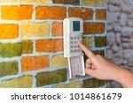 woman push on keypad of burglar ... | Shutterstock . vector #1014861679