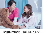 smiling nurse and young patient ...   Shutterstock . vector #1014875179