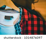 shirt weighs on the rack in the ... | Shutterstock . vector #1014876097