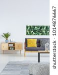 plant on wooden cupboard next... | Shutterstock . vector #1014876667