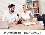 man and woman in white shirts... | Shutterstock . vector #1014889114