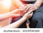 caregiver  carer hand holding... | Shutterstock . vector #1014930184