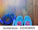 sport shoes and jumping rope on ... | Shutterstock . vector #1014938905