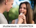 happy teen couple sharing... | Shutterstock . vector #1014947524