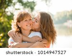 teenage girl hugging and... | Shutterstock . vector #1014947527