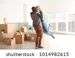 young happy couple in room with ... | Shutterstock . vector #1014982615