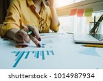 businesswoman analysis... | Shutterstock . vector #1014987934