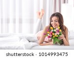 beautiful woman with bouquet of ... | Shutterstock . vector #1014993475