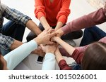 people putting hands together ... | Shutterstock . vector #1015026001