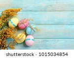 easter eggs with mimosa flowers ... | Shutterstock . vector #1015034854