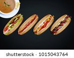 a few sandwiches of a picnic on ... | Shutterstock . vector #1015043764