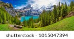 Amazing tourquise Oeschinnensee with waterfalls and Swiss Alps, Kandersteg, Berner Oberland, Switzerland.
