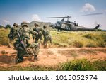 soldiers boarding a military... | Shutterstock . vector #1015052974