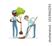 kids planting tree. boys in... | Shutterstock .eps vector #1015063291