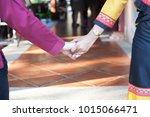 asian couple holding hands. | Shutterstock . vector #1015066471