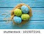 painted easter eggs in the nest ...   Shutterstock . vector #1015072141