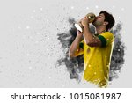 Stock photo brazilian soccer player coming out of a blast of smoke celebrating with a trophy in his hand 1015081987