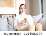 a smiling brunette mature woman ...   Shutterstock . vector #1015083379