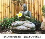 buddha sculpure with yellow... | Shutterstock . vector #1015094587