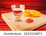 mezcal shot with orange slices...   Shutterstock . vector #1015110871
