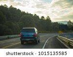 family truck traveling on the... | Shutterstock . vector #1015135585