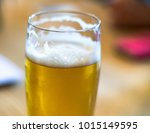 a glass of light beer on the... | Shutterstock . vector #1015149595