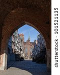 A view through the gate into the street Mariacka in Gdansk, Poland. - stock photo