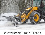 Yellow Tractor With Snowplow...