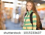 young student girl in library | Shutterstock . vector #1015233637