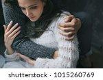 unrecognizable man hugs his... | Shutterstock . vector #1015260769