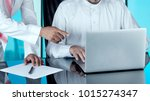 arab businessmen at disk... | Shutterstock . vector #1015274347