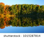 Beautiful fall colors reflect off a pond at Kettle Moraine State Forest in Wisconsin