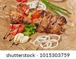 pork meat kebab with sauces and ... | Shutterstock . vector #1015303759