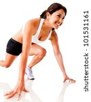 Female athlete in position ready to run - isolated over a white background - stock photo
