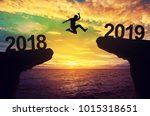 man jump between 2018 and 2019... | Shutterstock . vector #1015318651