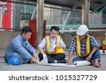 team of engineers discussing... | Shutterstock . vector #1015327729