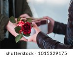 man gives present to her...   Shutterstock . vector #1015329175