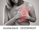 Small photo of The photo of heart is on the woman's body, Severe heartache, Having heart attack or Painful cramps, Pressing on chest with painful expression.