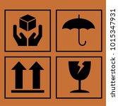 fragile symbol on cardboard... | Shutterstock .eps vector #1015347931
