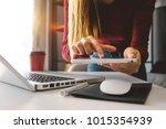 businesswoman hand using smart...   Shutterstock . vector #1015354939