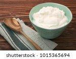 homemade yogurt or a sour cream ... | Shutterstock . vector #1015365694